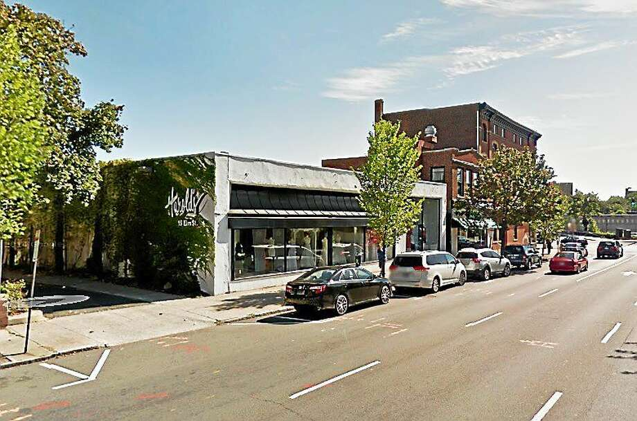 Members of the Downtown-Wooster Square Management Team were shown a proposal on Tuesday from a development group looking to transform the old Harold's Bridal Shop location on Elm Street into a five-story apartment building featuring ground-level retail space. Photo: (Courtesy - Google Maps)