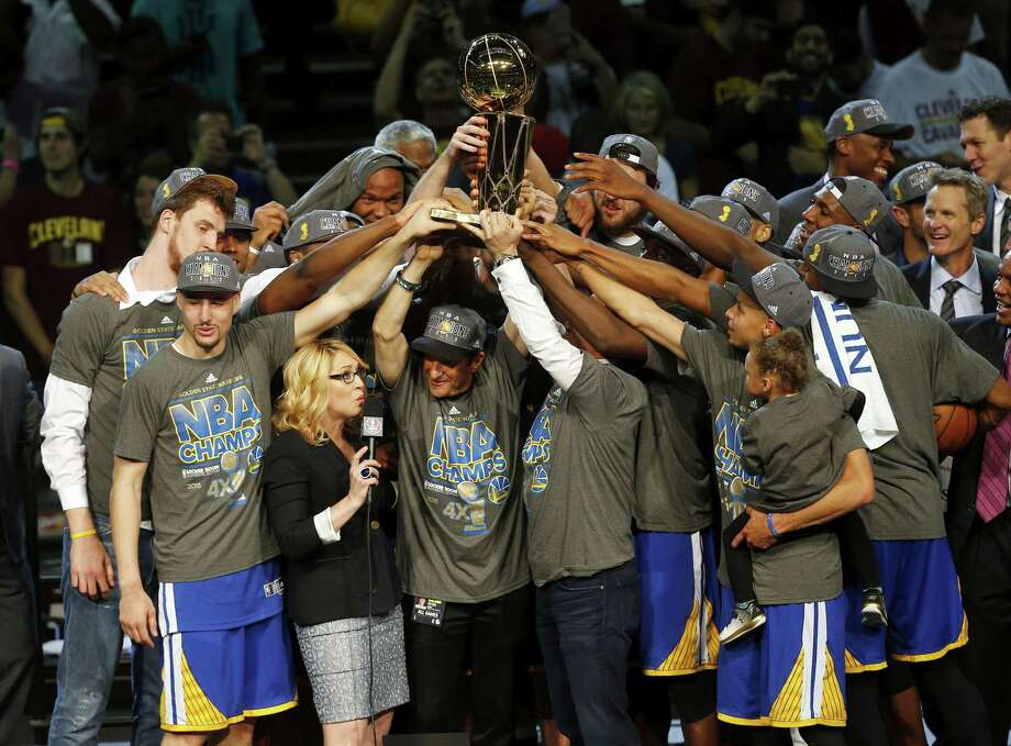 The members of the Golden State Warriors celebrate after winning the NBA Finals against the Cleveland Cavaliers. Photo: The Associated Press   / AP