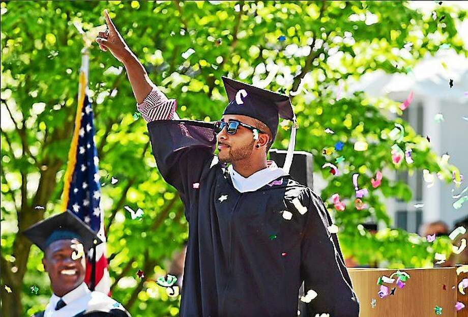 Elvis Santana shot off a confetti cannon just before receiving his bachelor of arts degree at the 92nd commencement exercise at Albertus Magnus College, Rosary Hall on Sunday, May 17, 2015. Photo: Catherine Avalone--New Haven Register