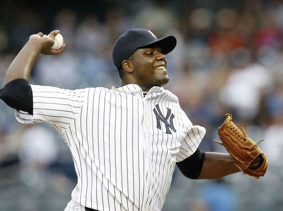 Yankees starting pitcher Michael Pineda delivers during the first inning. Photo: Kathy Willens  — The Associated Press   / AP