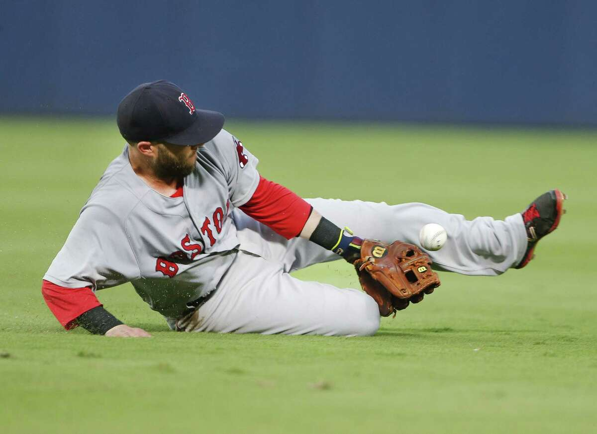 A ground ball by Atlanta Braves' Pedro Ciriaco gets past Boston Red Sox second baseman Dustin Pedroia (15) in the fourth inning Wednesday. Pedroia was charged with an error.