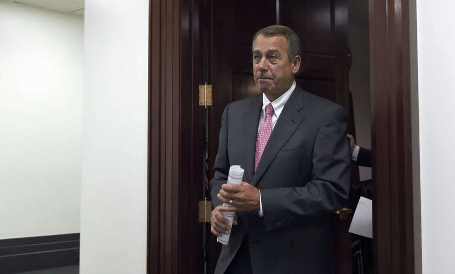 House Speaker John Boehner of Ohio arrives for a news conference on Capitol Hill in Washington. The House debates and votes for final passage on NSA Surveillance legislation, known as the USA Freedom Act. Photo: AP Photo   / AP
