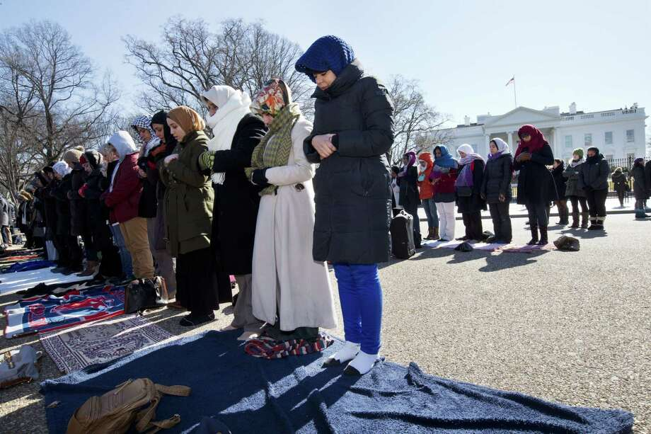 Fatima Chrifi, a teacher at Georgetown University, center, prays with a group of Muslims and their supporters during Friday prayers outside the White House in Washington, on Feb. 13, 2015, in the wake of the murder of three young North Carolina Muslims. Photo: AP Photo/Jacquelyn Martin   / AP