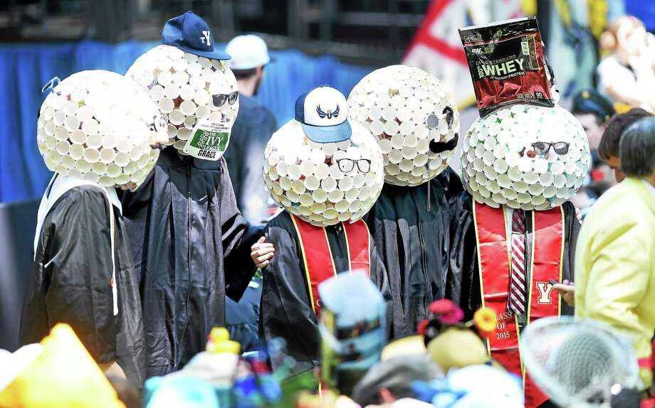 Students dress in whimsical hats for Class Day at Yale University Sunday. Photo: Arnold Gold — New Haven Register