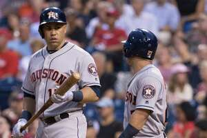 Houston Astros' Carlos Beltran, left, listens to Jose Altuve, right, who just scored a run during the third inning of a baseball game against the Philadelphia Phillies, Monday, July 24, 2017, in Philadelphia. (AP Photo/Chris Szagola)