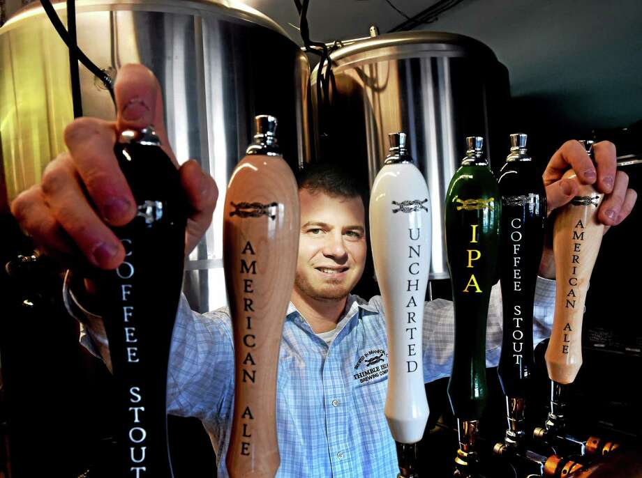 Justin Gargano, CEO and co-founder at the Thimble Island Brewery in Branford in the tasting area of the brewery Wednesday, February 11, 2015. Photo: (Peter Hvizdak - New Haven Register)   / ©2015 Peter Hvizdak