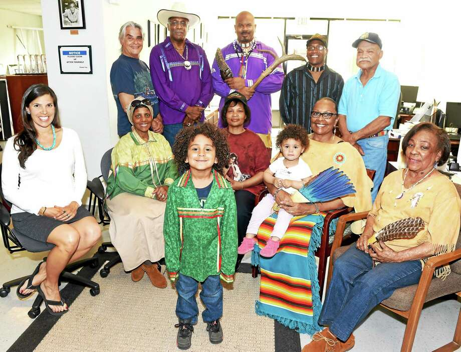The Connecticut Native American Inter-Tribal Urban Council at NAACP offices in New Haven. Front row, from left, Tasce Bongiovanni of New Haven, Zakiyyah Peters Hasan of Hamden, Velisha Cloud of New Haven, Jennifer Rawlings of New Haven with grandchildren Dyami Pimentel, 5, of New Haven, and Jaylyn Rawlings, 2, of New Haven, and Barbara Harrell-Little of New Haven. Back row, from left: J. Goins of New Haven, Jim Rawlings of New Haven, Richard Cowes of New Haven, Donte Hall of New Haven and Edward Jackson of North Haven. Photo: Peter Hvizdak — New Haven Register   / ?2015 Peter Hvizdak