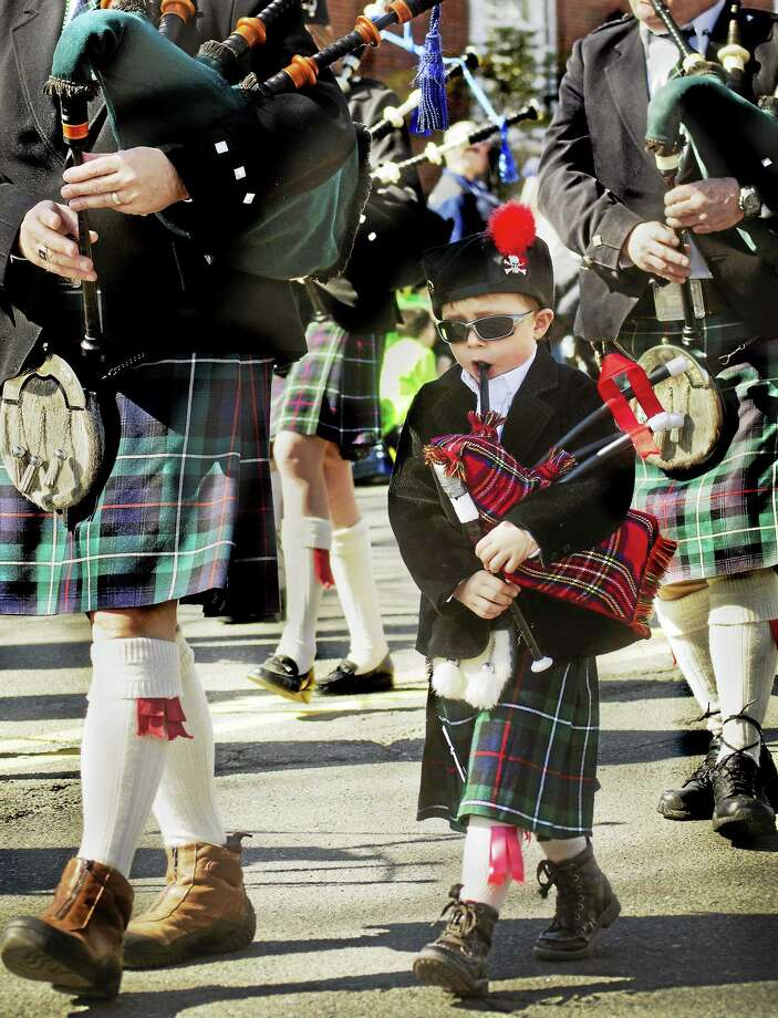 Philip Snowbeck marches with the Gaelic Highland Pipe Band at last year's parade. Photo: Register File Photo