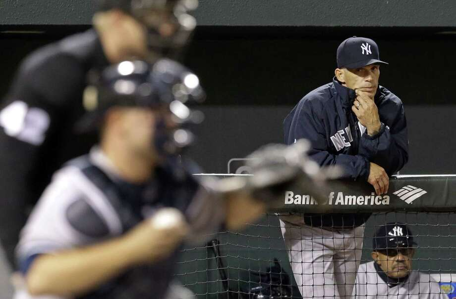 New York Yankees manager Joe Girardi watches Yankees catcher Brian McCann and home plate umpire Sean Barber from the dugout in the sixth inning of Wednesday's 7-5 loss to the Orioles. Photo: Patrick Semansky  — The Associated Press   / AP