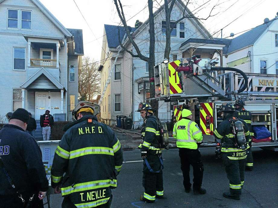 The Red Cross is helping four people after a fire Thursday afternoon damaged a home at 518 Elm St. in New Haven. Officials say the fire started in the third-floor kitchen. Photo: (Wes Duplantier -- New Haven Register)