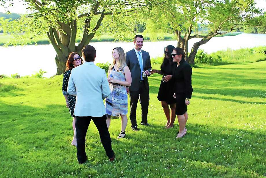 "Contributed photo  Guests enjoy an evening at the Florence Griswold Museum during ""YP on the River."" Photo: Journal Register Co."