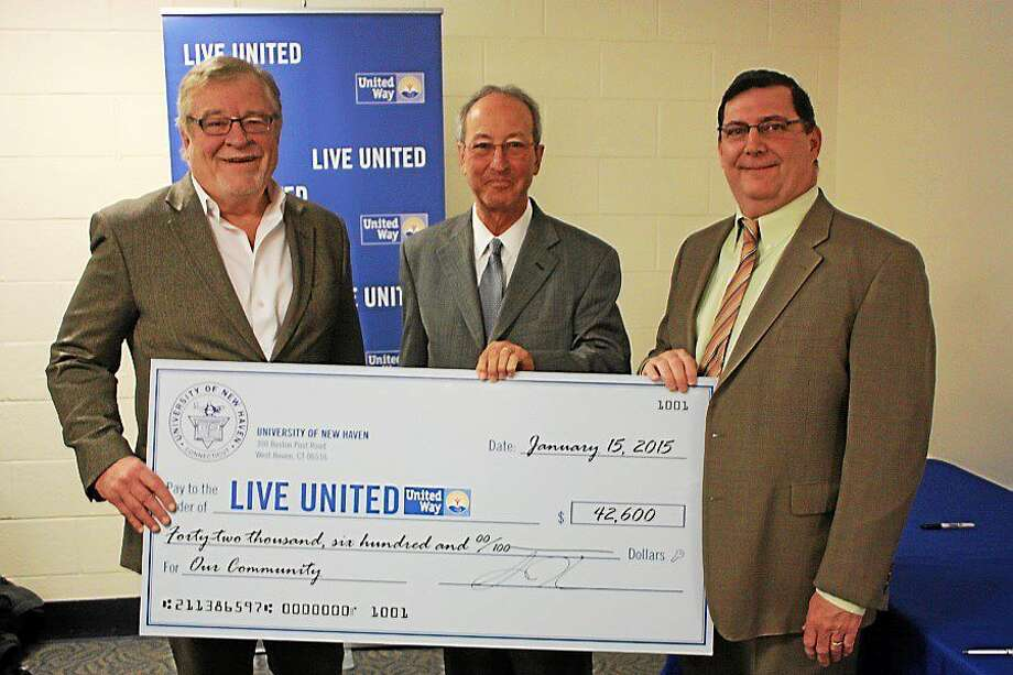 University of New Haven President Dr. Steven H. Kaplan, center, presented a check to United Way of Greater New Haven President and CEO Jack Healy, left, with West Haven Mayor Edward O'Brien looking on at a ceremony Jan. 8 at UNH. Photo: Courtesy Of The United Way Of Greater New Haven