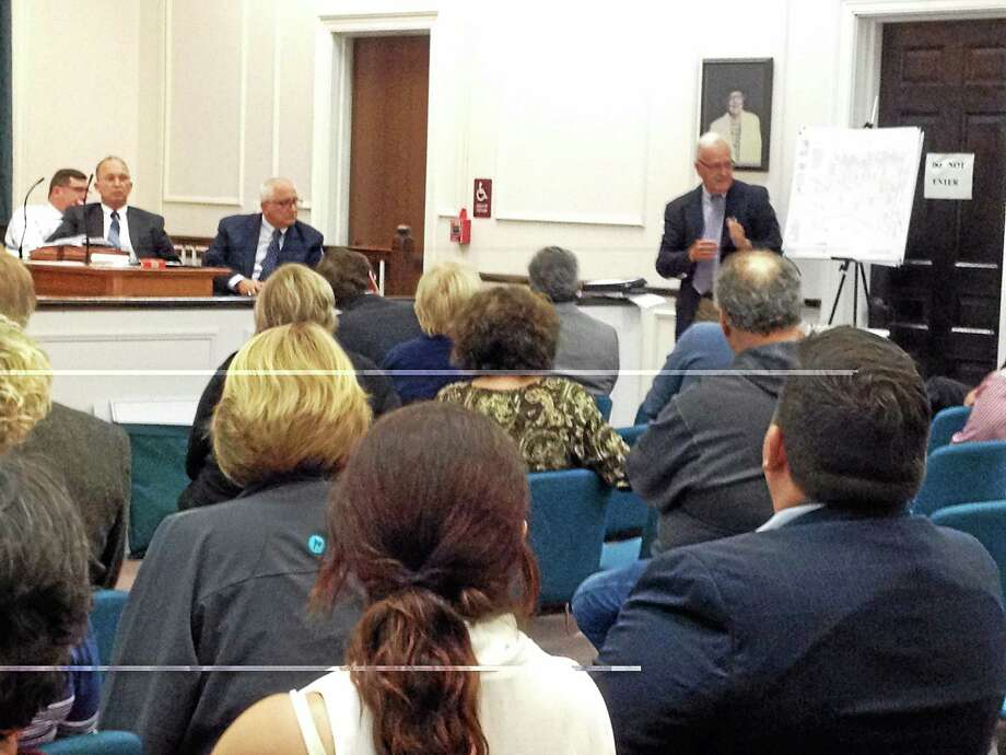 MARK ZARESTSKY — NEW HAVEN REGISTER  Peter Burns of DeCarlo & Doll discusses The Haven South MDP with the West Haven Planning and Zoning Commission Monday night. Photo: Journal Register Co.