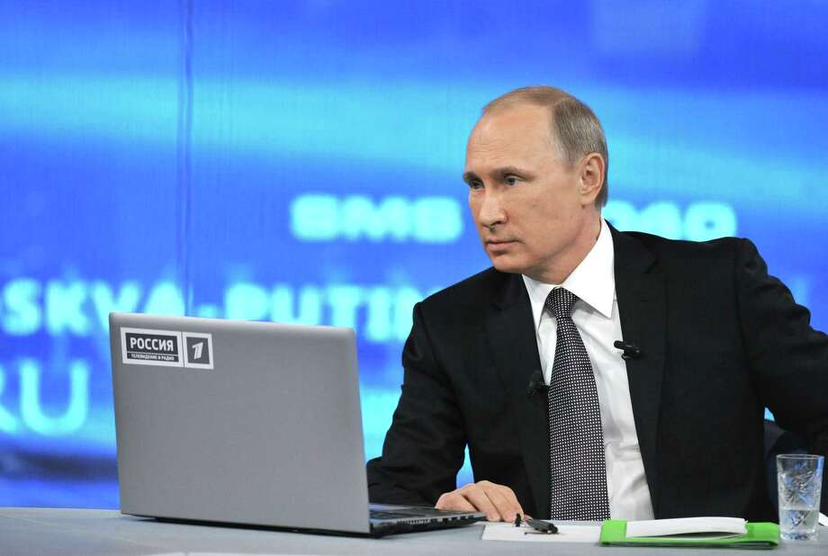 """Russian President Vladimir Putin,listens during an annual call-in show on Russian television """"Conversation With Vladimir Putin""""  in Moscow, Russia on April 16, 2015. President Vladimir Putin sternly urged the West to respect Russia's interests in global affairs and defended his move to sanction the delivery of a long-range air defense missile system to Iran during a marathon TV call-in show with the nation. Photo: Mikhail Klimentyev, RIA Novosti, Presidential Press Service Via AP   / RIA NOVOSTI KREMLIN"""