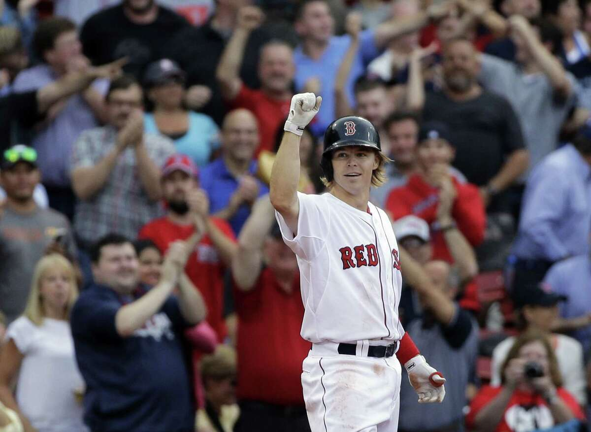 Boston's Brock Holt gestures after hitting a triple in the eighth inning. Holt hit for the cycle in the contest.