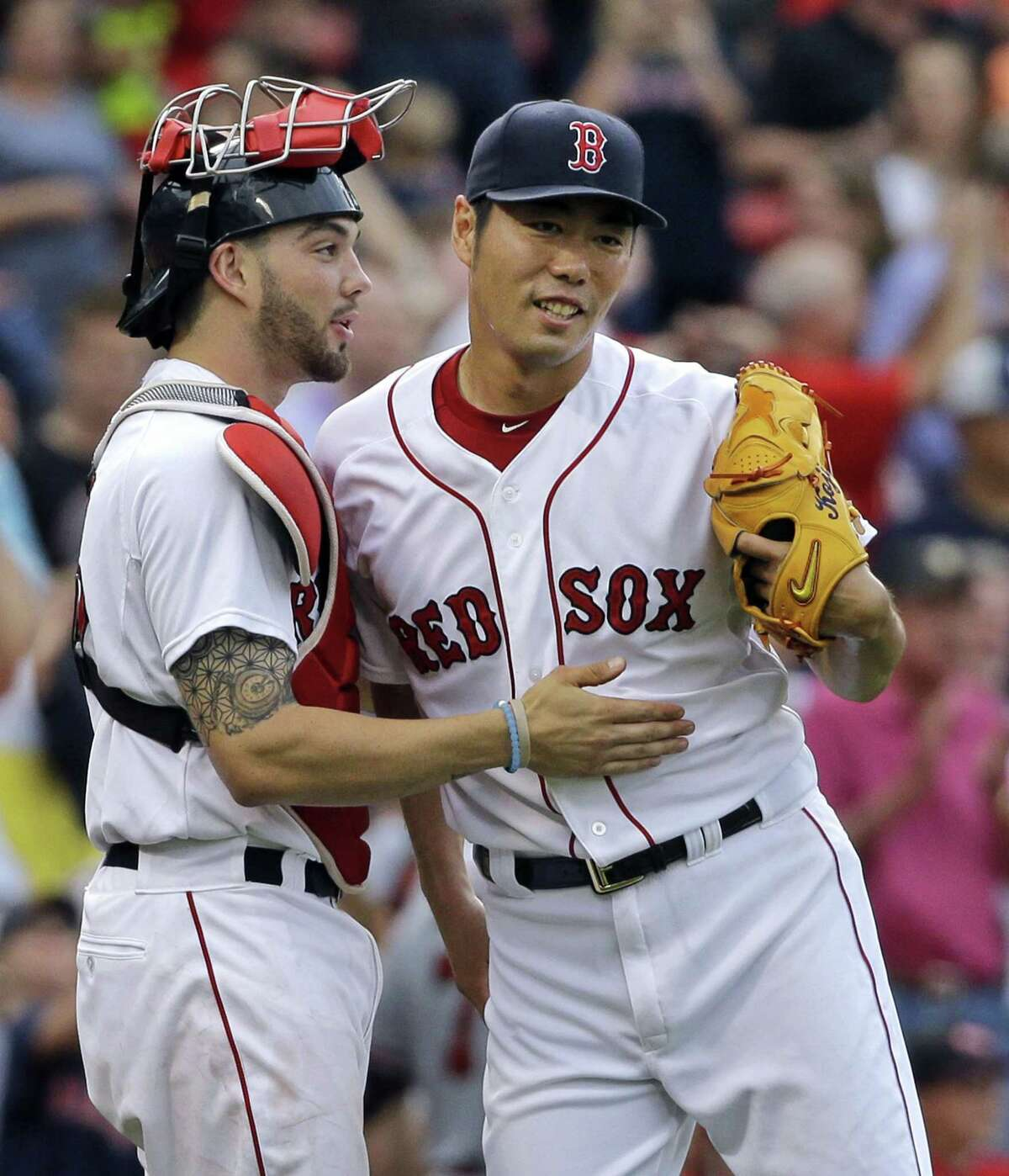 Boston relief pitcher Koji Uehara celebrates with catcher Blake Swihart after the Red Sox defeated the Braves 9-4 at Fenway Park on Tuesday.