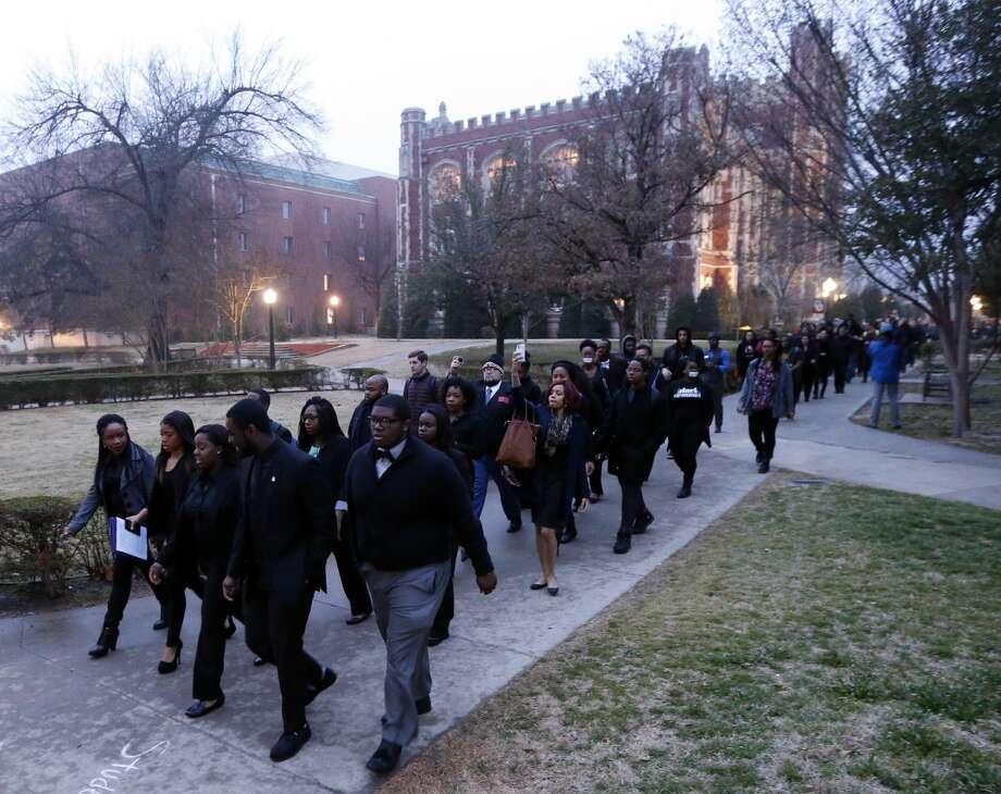 Students at the University of Oklahoma protest a fraternity's racist comments on March 9, 2015, in Norman, Okla. (AP Photo/The Oklahoman, Steve Sisney) Photo: AP / The Oklahoman