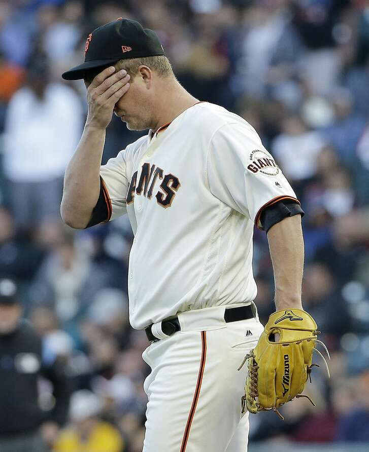 San Francisco Giants pitcher Matt Cain reacts after allowing an RBI-double to Pittsburgh Pirates' Josh Bell during the first inning of a baseball game in San Francisco, Monday, July 24, 2017. (AP Photo/Jeff Chiu)