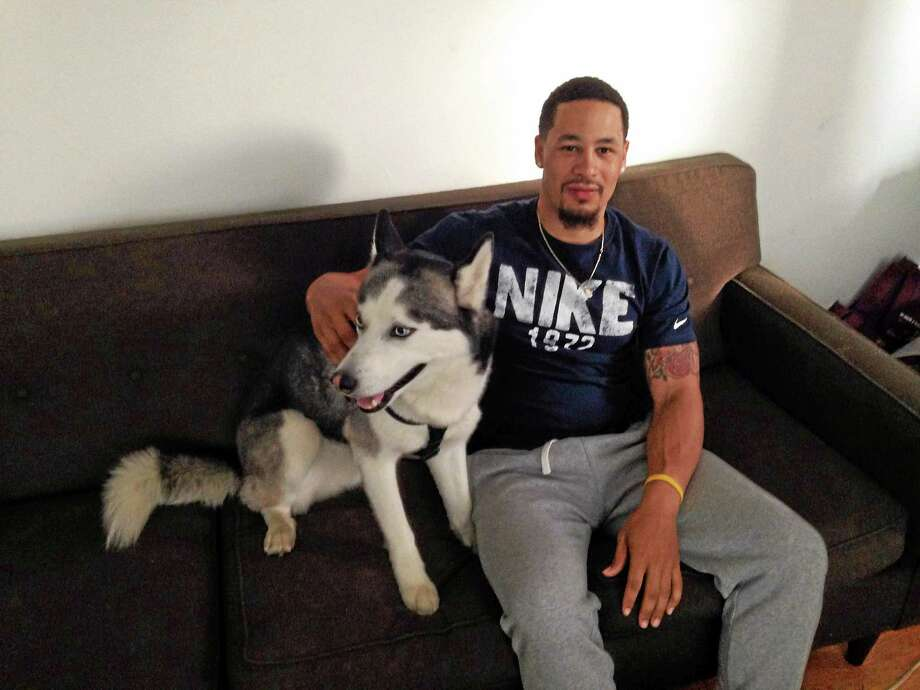 Nathian Dohna with his dog Polo in his West Haven home. Photo: Kate Ramunni — New Haven Register
