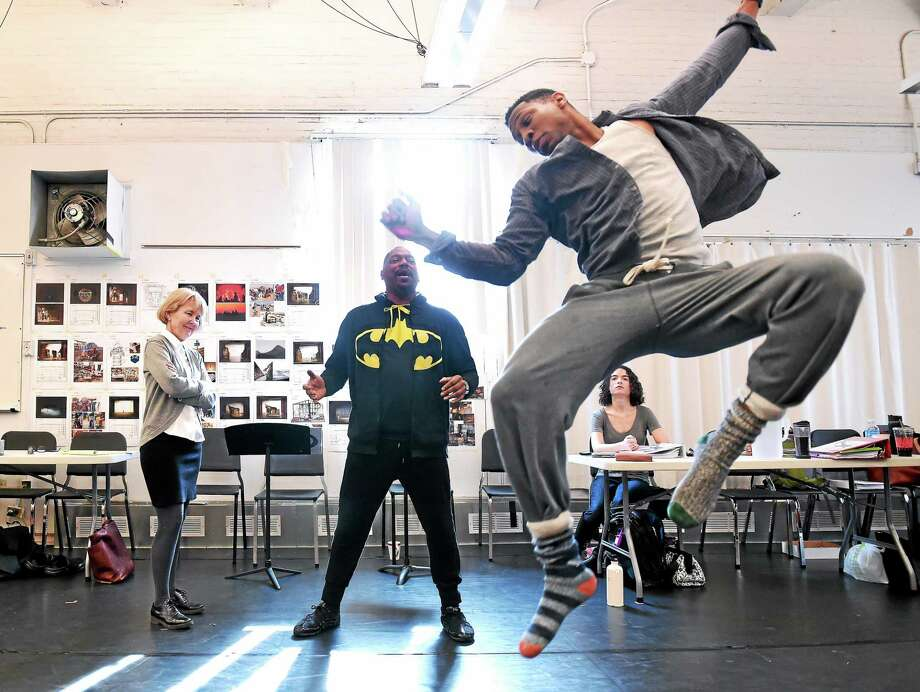 Director Liz Diamond and choreographer Randy Duncan watch Jonathan Majors practice a dance move. Photo: Arnold Gold — New Haven Register
