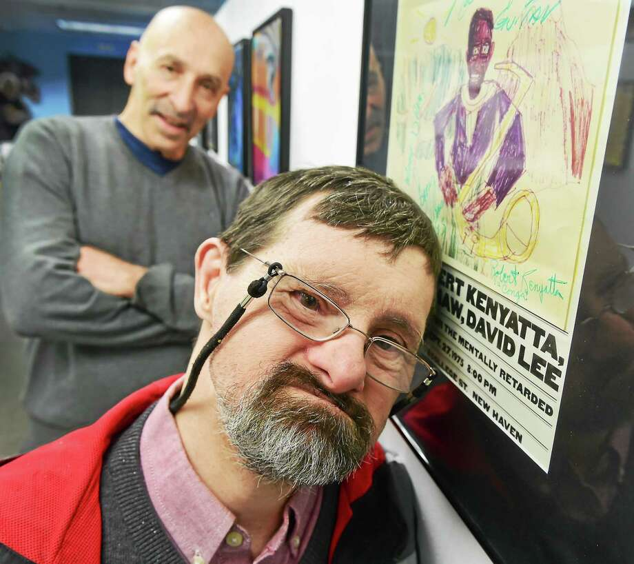 """Artist Bruce Gillespie, who has Down syndrome, and friend Sam Goldenberg, left, were at the opening of """"Visual Riffs: Reinterpreting Jazz Masters"""" at the Arts Council of Greater New Haven's Sumner McKnight Crosby Jr. Gallery, where Gillespie's work is being shown. Goldenberg inspired Gillespie to create the drawings for a jazz concert series he produced over the years. The poster shown here was for a Sonny Rollins Quintet concert. Photo: Peter Hvizdak — New Haven Register   / ©2015 Peter Hvizdak"""