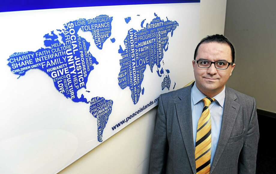 (Arnold Gold-New Haven Register)  Mehmet Erdogdu, Director of the Connecticut chapter of the Peace Islands Institute, is photographed in the New Haven office on 3/10/2015. Photo: Journal Register Co.