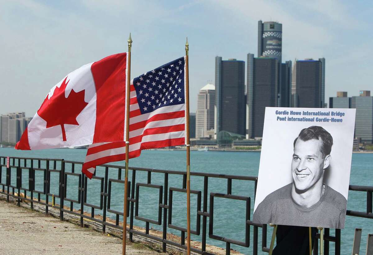 A photograph of Gordie Howe is displayed on the riverfront after a news conference Thursday in Windsor, Ontario, announcing that a planned bridge connecting Detroit, rear, and Windsor, will be named after the hockey Hall of Famer.