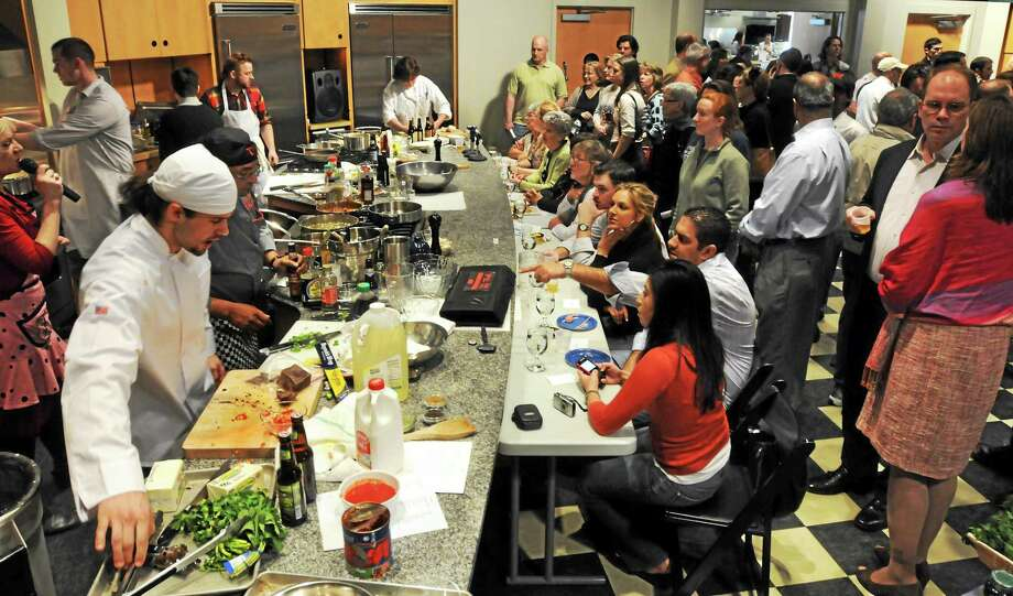 The Iron Chef Elm City scene typically looks like this one which was held in Wallingford in 2011. The competition takes place at the Omni New Haven Hotel at Yale ballroom on April 26. Photo: Mara Lavitt - New Haven Register File