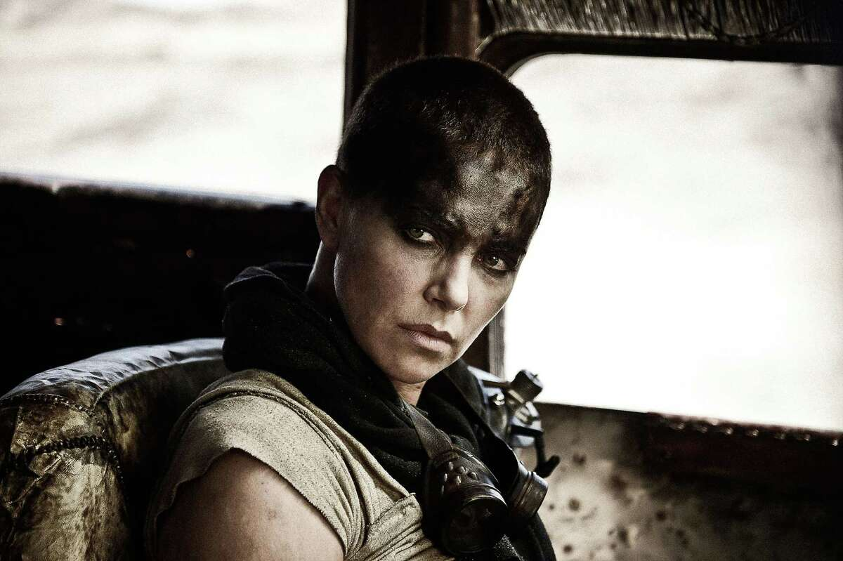 """This photo provided by Warner Bros. Pictures shows Charlize Theron as Imperator Furiosa in Warner Bros. Picturesí and Village Roadshow Picturesí action adventure film, ìMad Max: Fury Road,"""" a Warner Bros. Pictures release. (Jasin Boland/Warner Bros. Pictures via AP)"""