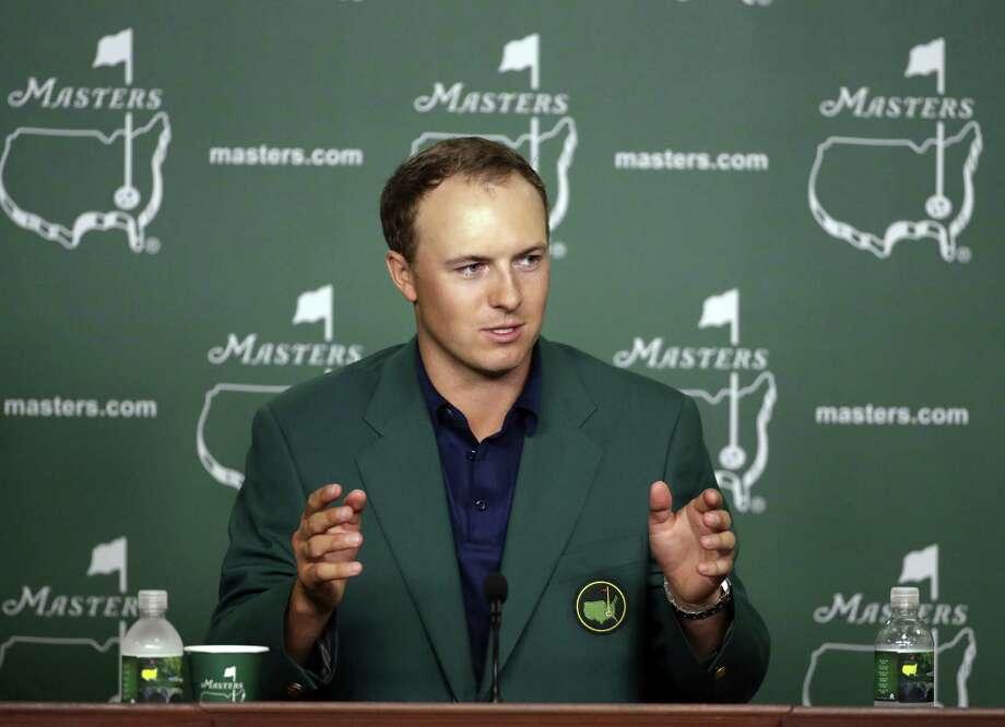 c3e1dd7dfb91b1 Jordan Spieth speaks to the media after winning the Masters golf tournament  Sunday