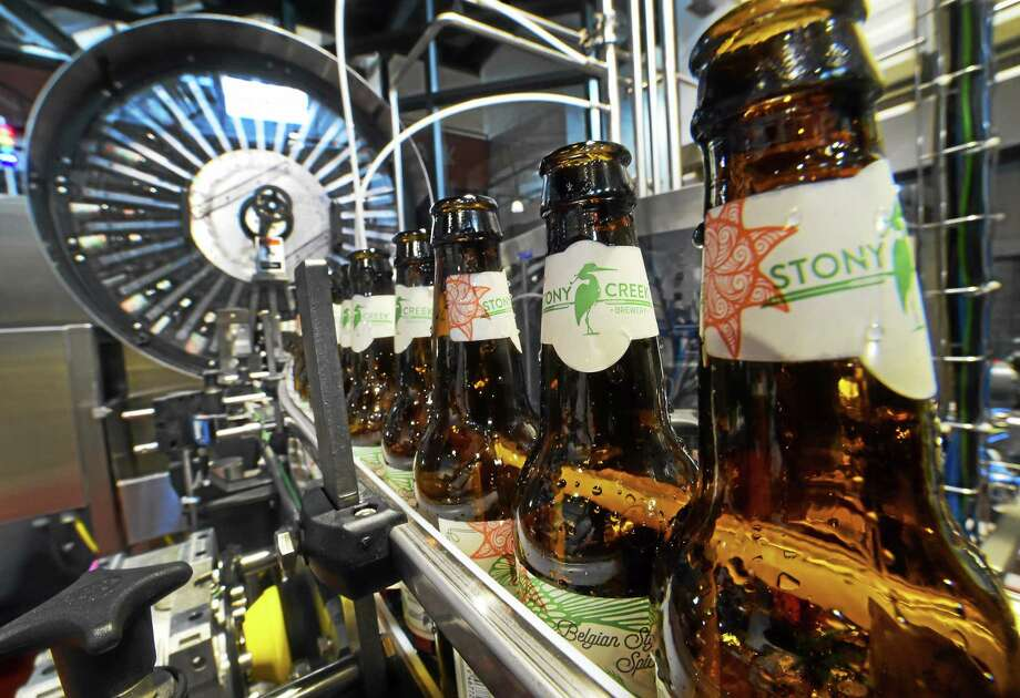 The Stony Creek Brewery bottle line that labels, dates, rinses, fills and caps beer as part of the bottling and packaging process on a conveyor  in the 30,000 square-foot facility at the Branford, Connecticut Wednesday, May 20, 2015. Photo: (Peter Hvizdak - New Haven Register)   / ©2015 Peter Hvizdak