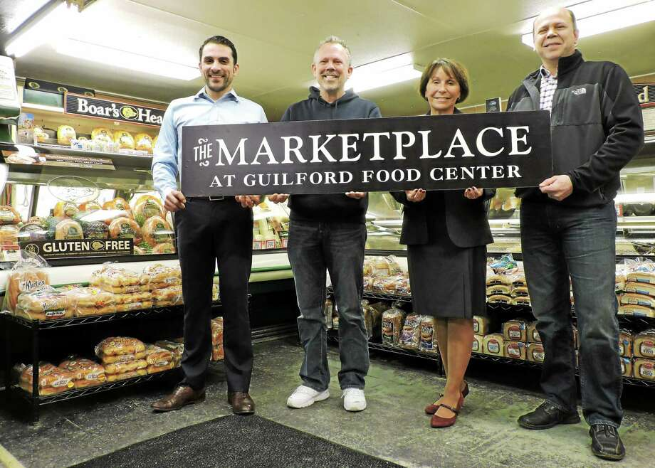 From left to right: Jason Iglesias, Ray Rosa , Dee Jacob and Ron Rosa celebrate the relaunching of the Guilford Food Center. Contributed photo Photo: Journal Register Co.