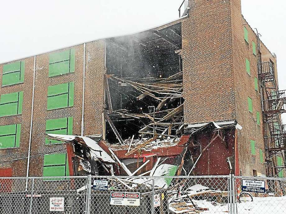 A portion of the former Carroll Cut-Rate Furniture building collapsed Monday in West Haven. Photo: Peter Hvizdak — New Haven Register