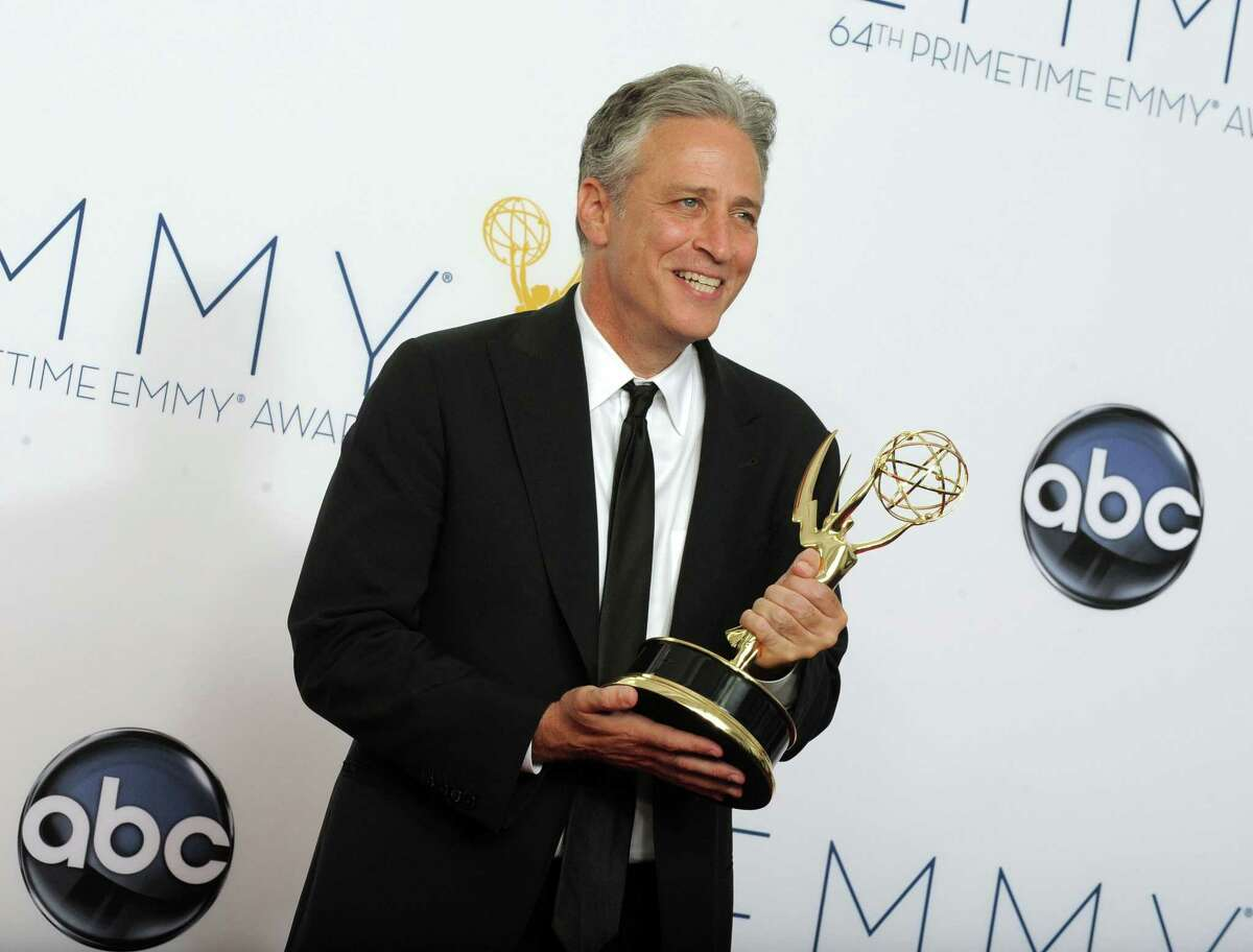 """FILE - In this Sept. 23, 2012 file photo, Jon Stewart, winner Outstanding Varety Series for """"The Daily Show With Jon Stewart"""", poses backstage at the 64th Primetime Emmy Awards in Los Angeles. Comedy Central announced Tuesday, Feb. 10, 2015, that Stewart will will leave """"The Daily Show"""" later this year."""