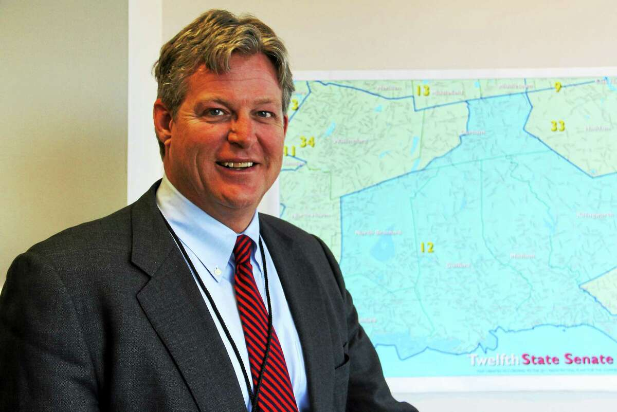 State Sen. Ted Kennedy Jr., D-12th, stands inside his office inside the Legislative Office Building next to a map of his district on Thursday in Hartford. Kennedy is set to begin his first term serving as a state senator, joining a tradition of public service that his family is known for.