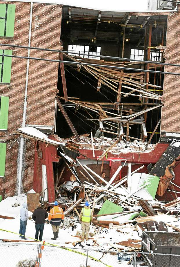 Nobody was hurt in a partial building collapse at Former Carroll Cut-Rate Furniture store Monday at 222 Boston Post Road in West Haven. The top three floors collapsed as workers were removing a loading dock. Photo: Peter Hvizdak — New Haven Register   / ©2015 Peter Hvizdak