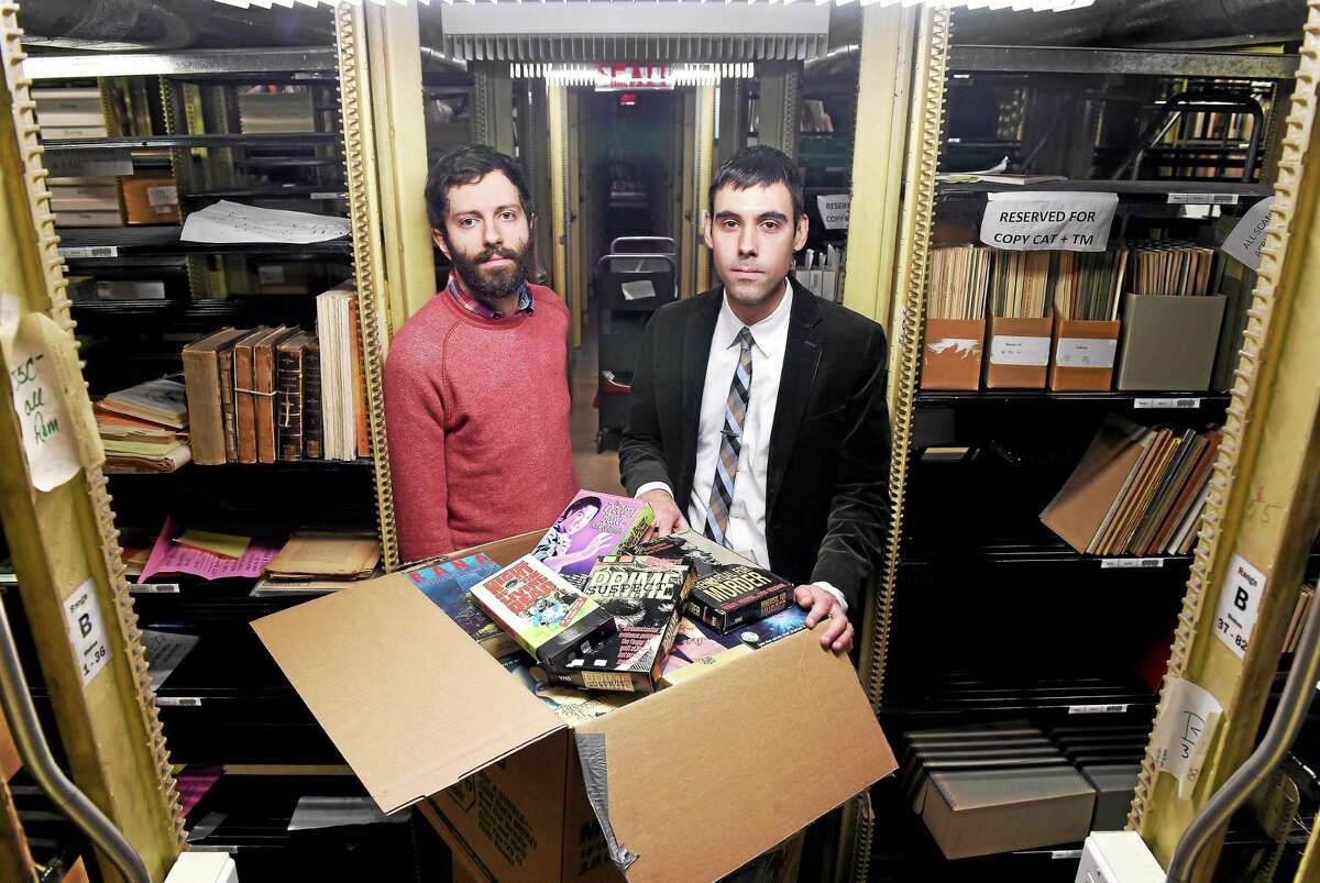 Yale doctoral student Aaron Pratt, left, and David Gary, Kaplanoff librarian for American history, are photographed in the basement of Sterling Memorial Library on 3/11/2015 with part of a collection of horror and exploitation VHS films recently acquired by Yale University.