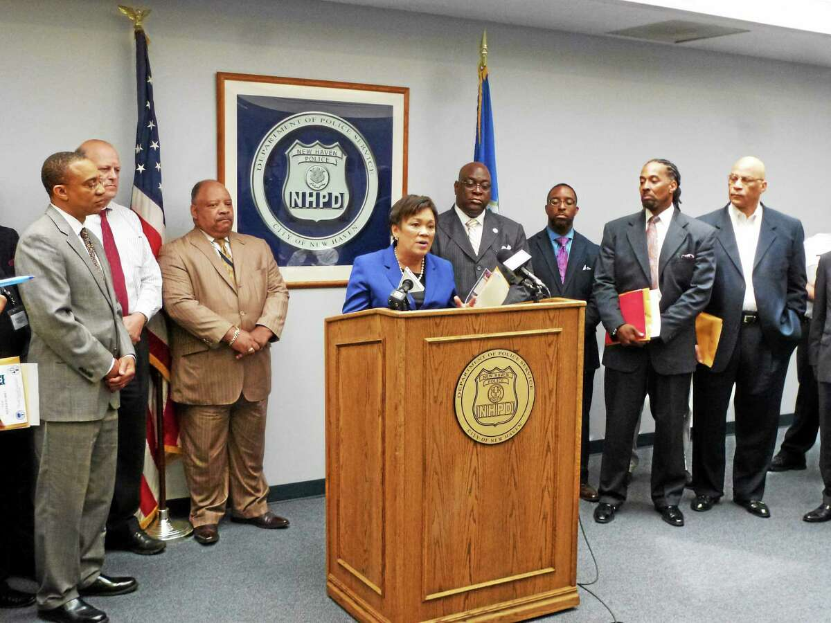 Mayor Toni N. Harp speaks as members of the police department and local church leaders held a press conference Tuesday to discuss community policing and the relationship between clergy and police.