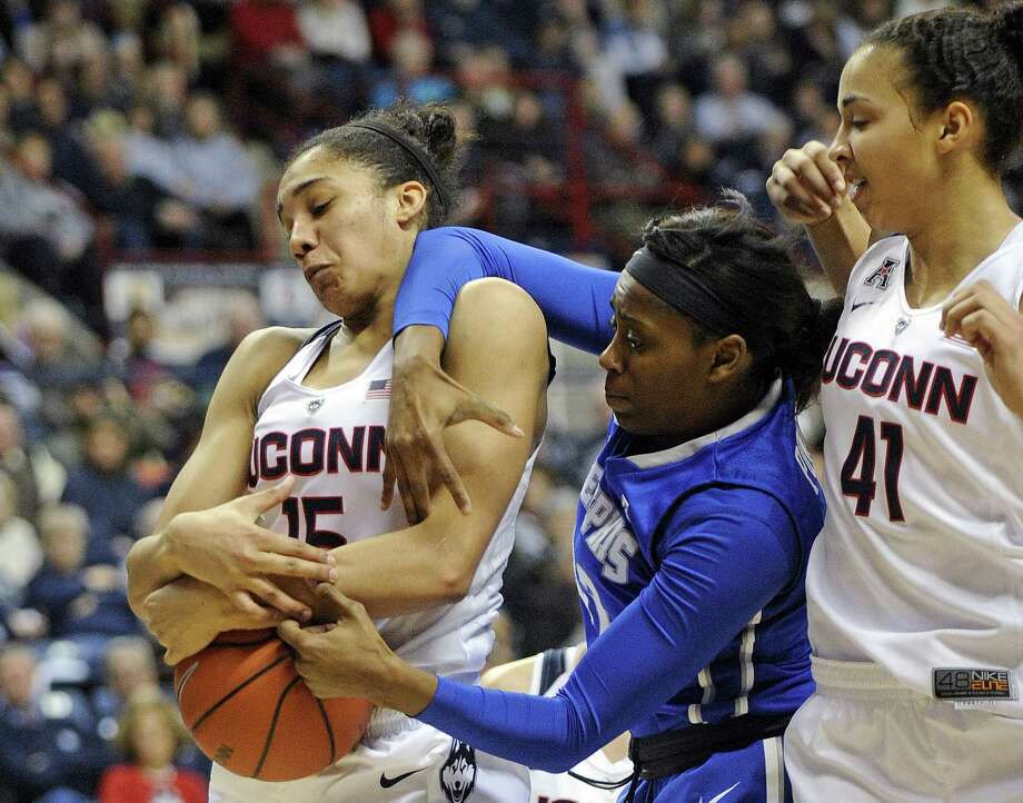 UConn's Gabby Williams (15) fights for a rebound with Memphis' Courtney Powell (32) as Kiah Stokes looks on during the Huskies' 87-24 victory on Feb. 28 in Storrs. Photo: Fred Beckham — The Associated Press   / FR153656 AP