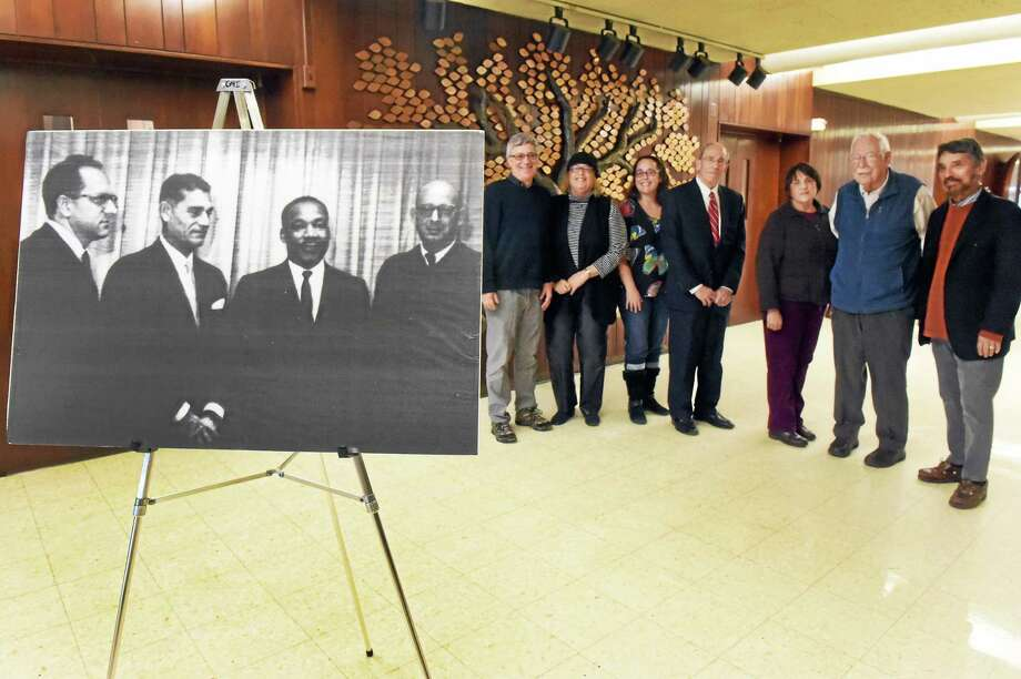 From left rear: Barry Berman of New Haven, Elaine and Jill Koufman of Maine, Mark Sklarz of New Haven, Betsy Rosenthal of Hamden, and Norman Rashba of Hamden recalled Oct. 20, 1961, when the Rev. Martin Luther King Jr. came to Hamden to preach at Congregation Mishkan Israel. At far right is Rabbi Herbert N. Brockman. In the 1961 photo are, left to right, Harry Sebran, cantor; Paul Press, president of the congregation; King and Rabbi Robert Goldburg. Photo: Peter Hvizdak — New Haven Register   / ©2015 Peter Hvizdak