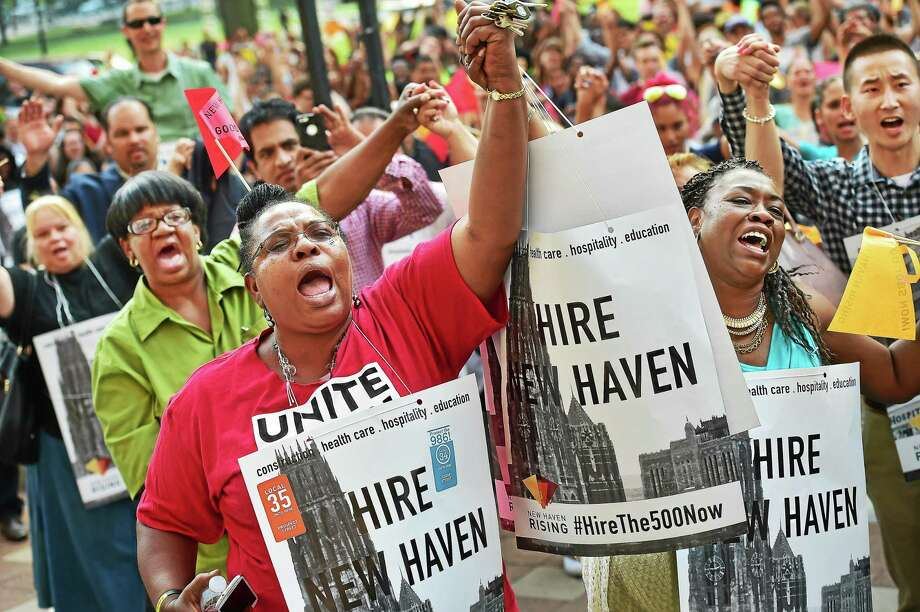 Ward 24 Alder Evette Hamilton and Rachel Parks of West Haven were among hundreds who rallied Thursday at New Haven City Hall, urging large employers, developers and construction companies to hire New Haven residents. Photo: Catherine Avalone — New Haven Register   / Catherine Avalone/New Haven Register