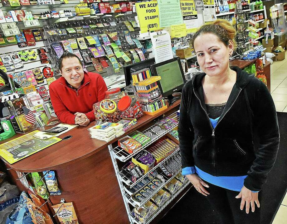 Marcia Chacon, owner of The Country Store at 677 Main Street in East Haven and her son, Paul Matute. Chacon emigrated from Ecuador and has operated the Latino market for since 1999. Photo: (Catherine Avalone - New Haven Register)   / New Haven RegisterThe Middletown Press