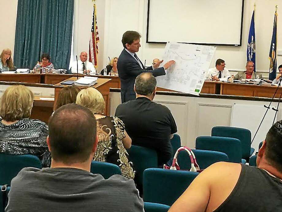 West Haven's outside attorney, Gary O'Connor, discusses the Haven South plan before the City Council Wednesday night. Photo: Photo By Mark Zaretsky - New Haven Register