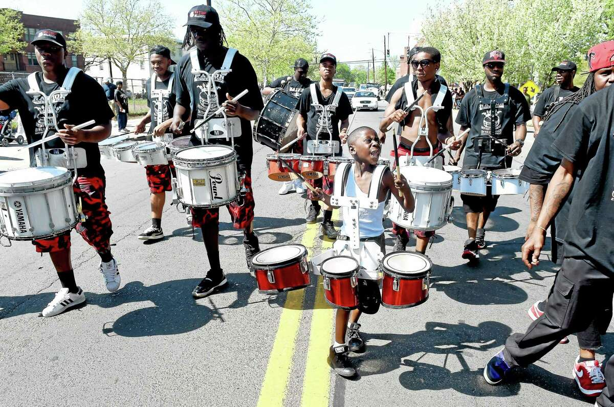 (Arnold Gold-New Haven Register) Julian Threadgill (center), 7, drums with the New Haven based Nation Drill Squad and Drum Corp during the 53rd Annual Freddie Fixer Parade in New Haven.