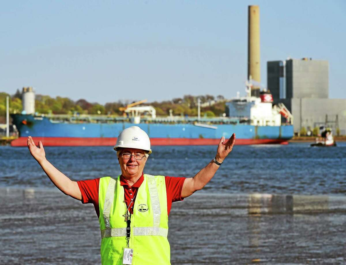 """(Peter Hvizdak - New Haven Register)Ruth Setaro, chaplain for the Connecticut deep water ports, is shown at the New Haven Port last week. She works for the Seafarers International House, which is a ministry of the Evangelical Lutheran Church of America. Setaro helps the arriving crews by providing transportation and counseling. """"Sometimes they just need someone to listen,"""" Setaro said."""