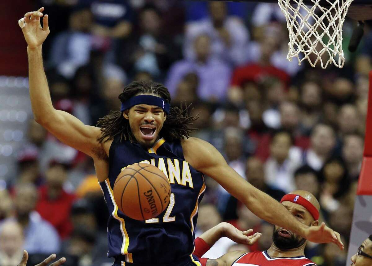 In this Nov. 5, 2014 photo, Indiana Pacers forward Chris Copeland (22) loses control of the ball as he is guarded by Washington Wizards forward Drew Gooden (90) and forward Otto Porter Jr. (22) during the first half of an NBA basketball game in Washington.