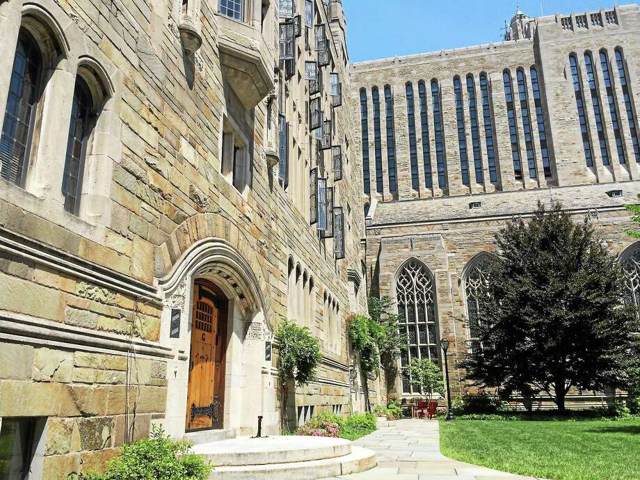 The old campus at Yale includes 14 buildings with a main entrance from the New Haven Green known as Phelps Gate.