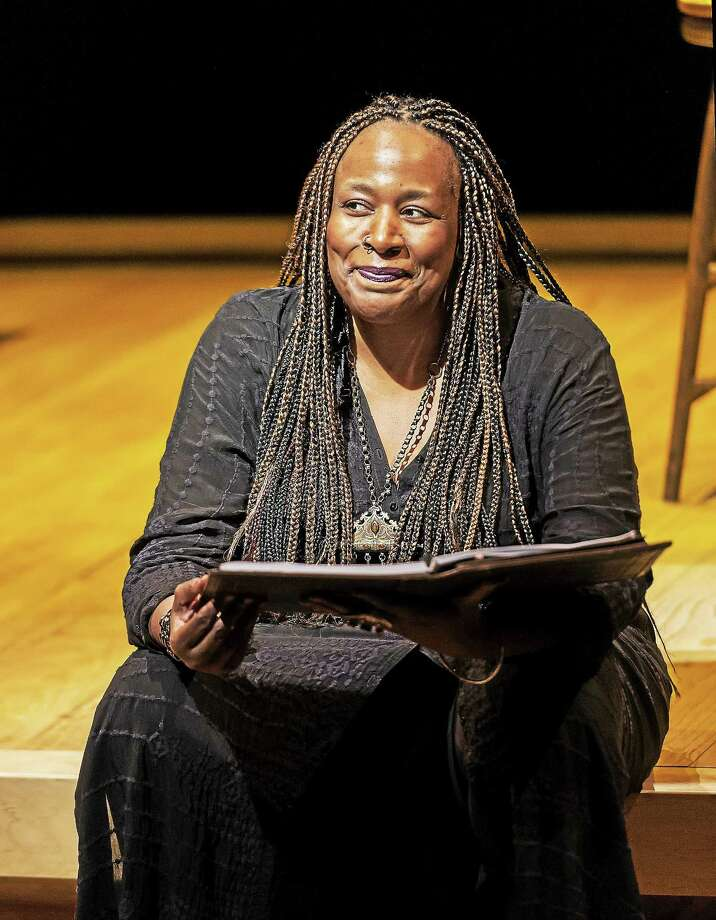 """Dael Orlandersmith takes theatergoers to Père Lachaise Cemetery in Paris as """"Forever"""" unfolds on Stage II at Long Wharf Theatre in New Haven. Photo: Craig Schwartz   / ALL uses MUST contain photo credit: Photo By Craig Schwartz © 2014"""