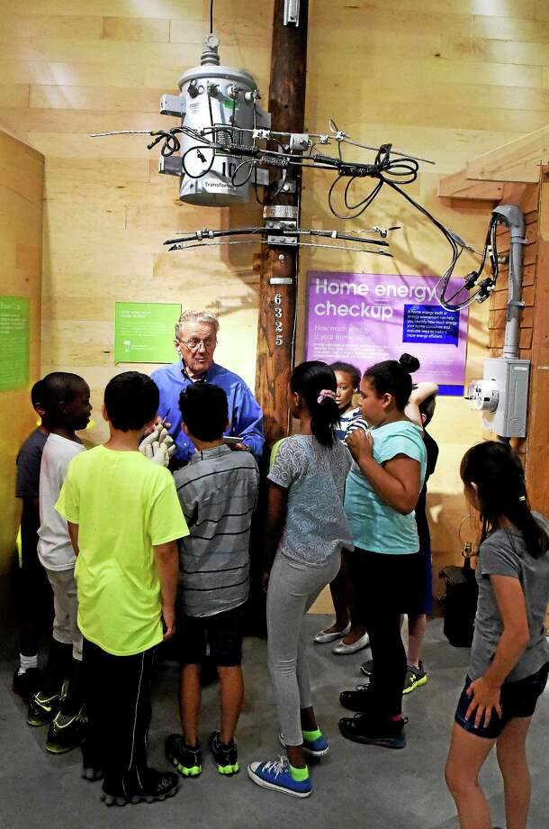 Ernie Price, an educator at the Energize Connecticut Center in North Haven, gives a short talk on safety around utility poles, downed wires and the job of an electric utility lineman to children from ACES. Photo: Peter Hvizdak — New Haven Register    / ©2015 Peter Hvizdak
