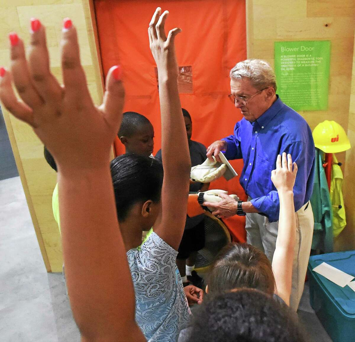 Ernie Price, an educator at the Energize Connecticut Center in North Haven, gives a short talk on safety around utility poles, downed wires and the job of an electric utility lineman to children from ACES.
